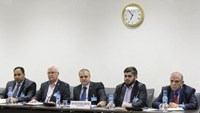 Members of the Syrian opposition delegation of the High Negotiations Committee (HNC) George Sabra (2nd L) delegation head Asaad Al-Zoubi (C) and Chief negotiator, Army of Islam rebel group's Mohammed Alloush (2nd R) attend a meeting with U.N. mediator on Syria Staffan de Mistura during Syria peace talks at the United Nations in Geneva, Switzerland, April 15, 2016. REUTERS/Fabrice Coffrini