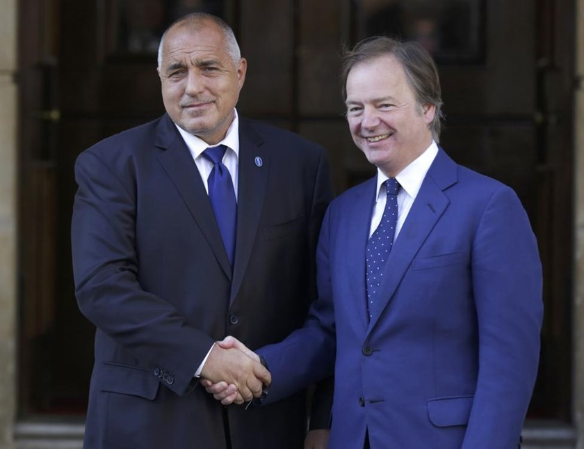 Boyko Borissov, the Prime Minister of Bulgaria (L) is met by Britain's Foreign Office minister Hugo Swire as he arrives at a summit on corruption at Lancaster House in central London, Britain, May 12, 2016.