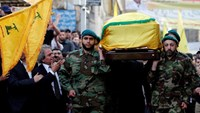 Hezbollah members carry the coffin of top Hezbollah commander Mustafa Badreddine, who was killed in an attack in Syria, as his brother mourns his death during his funeral in Beirut's southern suburbs, Lebanon, May 13, 2016.