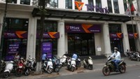 A man rides a motorcycle past the Vietnamese commercial Tien Phong bank in Hanoi May 13, 2016. Photo: Reuters