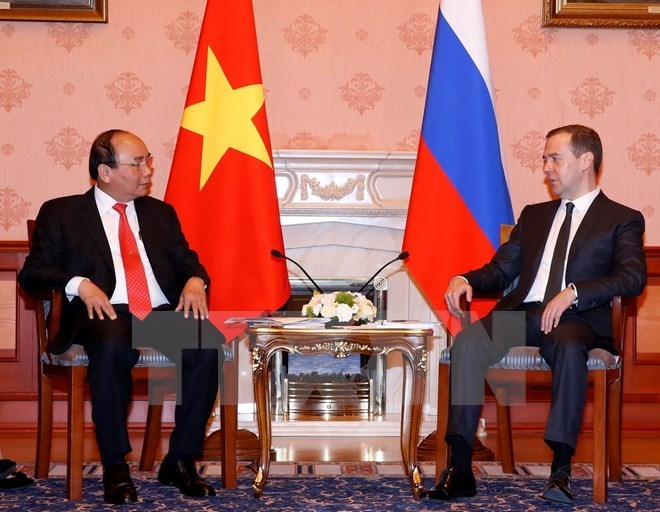 Prime Minister Nguyen Xuan Phuc (L) during talks with his Russian counterpart Dmitry Medvedev in Moscow