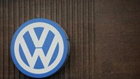 A giant logo of Volkswagen is pictured on the wall of its production facility in Wolfsburg, Germany, April 28, 2016.