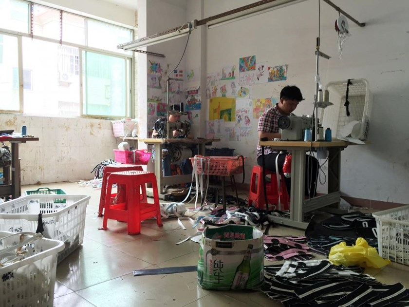 Workers work at a small-sized factory producing bags at Shiling town in Huadu, Guangdong province, China April 28, 2016.