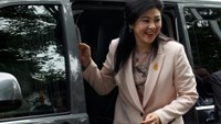Ousted former Thai Prime Minister Yingluck Shinawatra arrives at the Supreme Court for a trial on criminal negligence looking into her role in a debt-ridden rice subsidy scheme during her administration, in Bangkok, Thailand May 18, 2016.