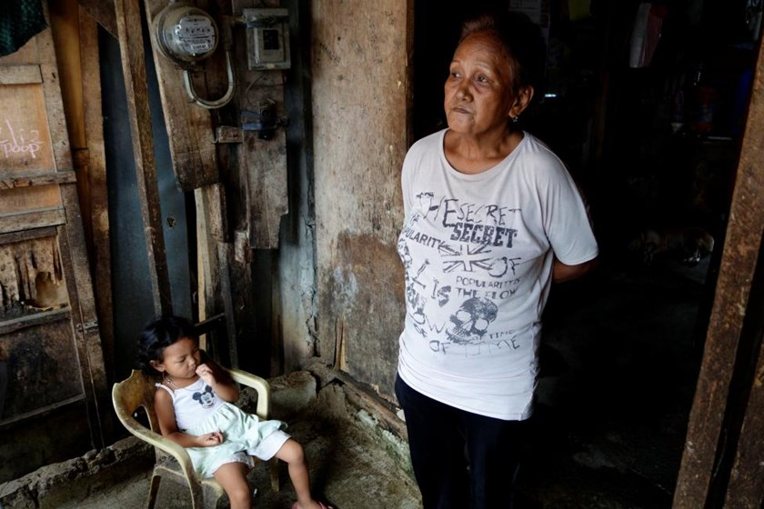 Clarita Alia, 62, stands at her home while talking about her four sons which have died in execution-style killings in Davao, Philippines May 14, 2016.
