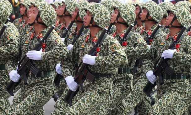Soldiers hold rifles while marching during a celebration to mark Reunification Day in Ho Chi Minh city, Vietnam April 30, 2015.
