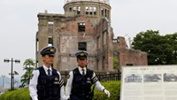 Police officers guard in front of the Atomic Bomb Dome at Peace Memorial Park in Hiroshima, Japan May 27, 2016.