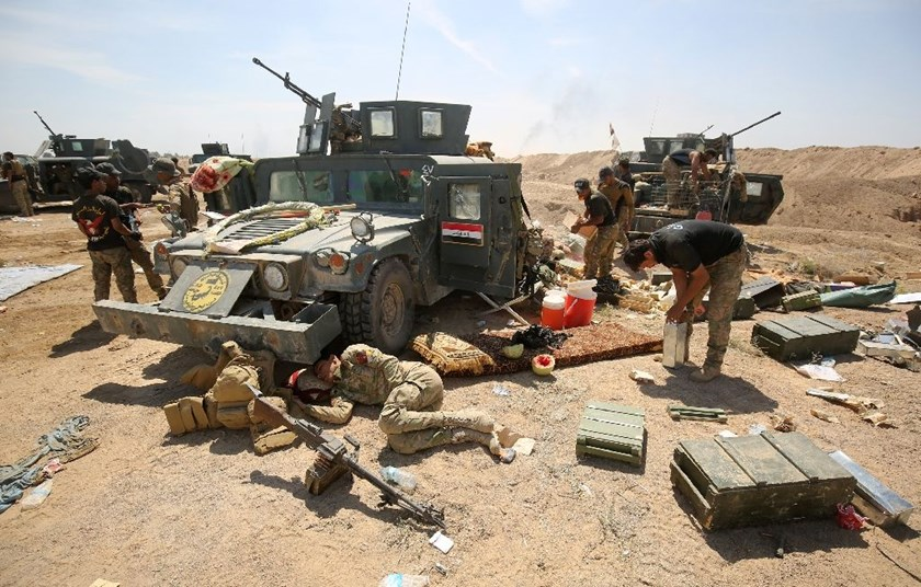 Pro-government forces rest after battling Islamic State group jihadists near al-Sejar village, north-east of Fallujah