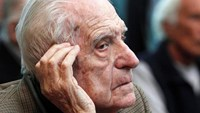 Argentina's former President and Army Chief Reynaldo Bignone sits in a courthouse during the first day of his trial, accused of participating in 'Operation Condor', in Buenos Aires March 5, 2013.
