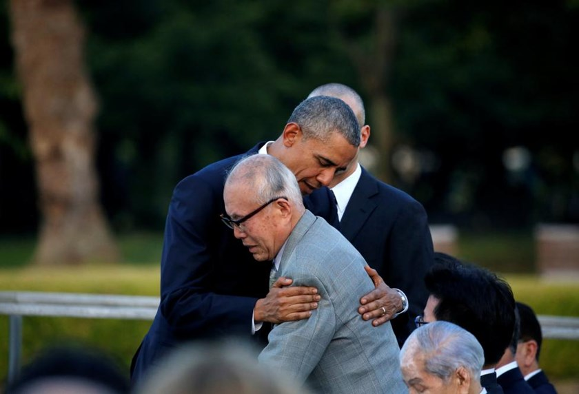 U.S. President Barack Obama (L) hugs an atomic bomb survivor Shigeaki Mori as he visits Hiroshima Peace Memorial Park in Hiroshima, Japan May 27, 2016