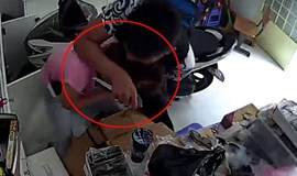 Caught on camera: shop owner thwarts brazen robbers