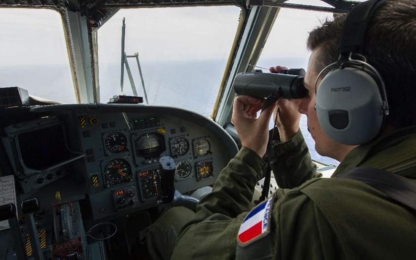 A French soldier searches for debris from the crashed EgyptAir flight MS804 over the Mediterranean Sea