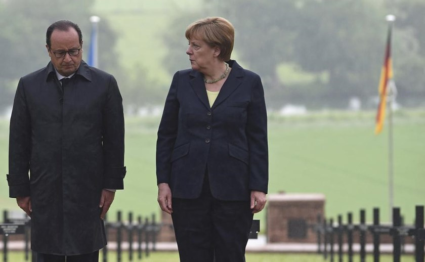 French President Francois Hollande and German Chancellor Angela Merkel attend a remembrance ceremony at a German cemetery in Consenvoye near Verdun, France, May 29, 2016, marking the 100th anniversary of the battle of Verdun, one of the largest battles of the First World War (WWI) on the Western Front.