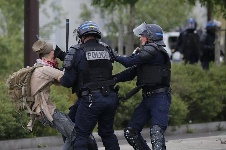 French police apprehend a youth during a demonstration to protest the government's proposed labour law reforms in Nantes, France
