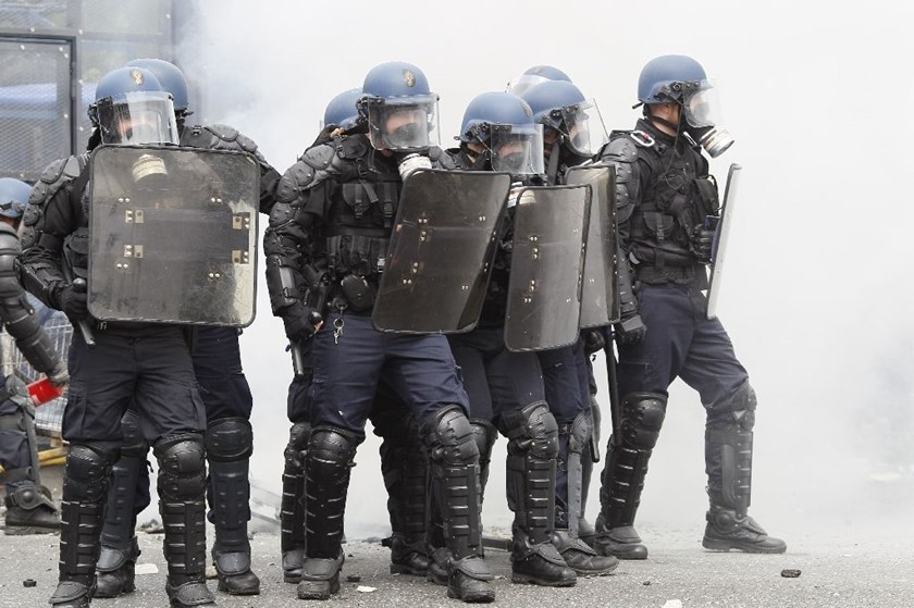 French riot police officers stand guard during a protest against the government's labour market reforms in Paris, on May 26, 2016