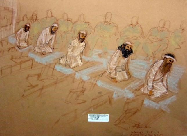Mustafa al Hawsawi, Ammar al Baluchi, Ramzi bin al Shibh, Walid Bin Attash, and Khalik Sheikh Mohammad, pray at their arraignment in this courtroom sketch reviewed and approved for release by a U.S. military security official, at Guantanamo Bay Navy Base, Cuba, May 5, 2012.