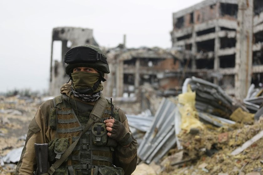 An armed pro-Russian separatist stands in front of the destroyed Donetsk International Airport, on June 1, 2016