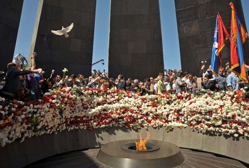 People lay flowers at the monument to Armenians killed by Ottoman Turks during World War I in Yerevan, pictured in 2014
