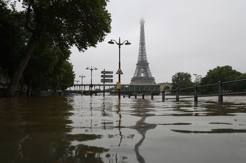 Flooding in Paris swelled the Seine river by 6.0 metres (20 feet) with a peak of up to 6.50 metres expected later, the French environment ministry said Friday