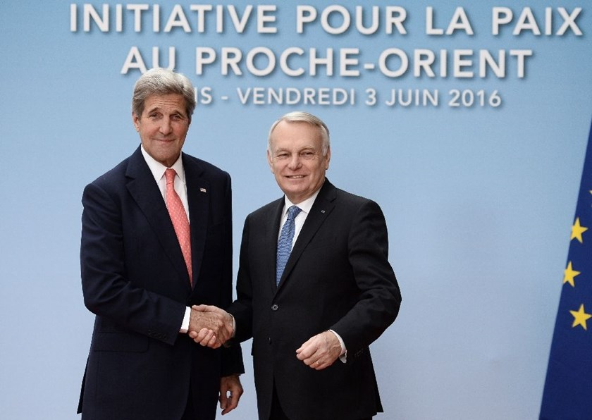 French Foreign minister Jean-Marc Ayrault (R) shakes hands with US Secretary of State John Kerry in Paris on June 3, 2016 for talks on the Israeli-Palestinian conflict