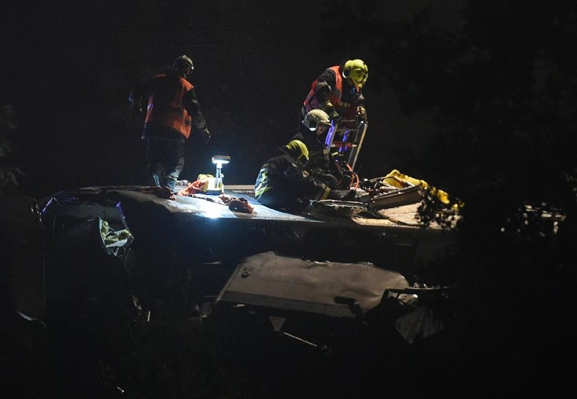 Rescue workers work on the roof of a passenger train after it collided with a goods train on June 5, 2016 near Saint-Georges-sur-Meuse, Belgium