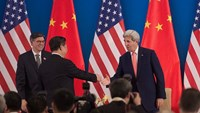 China's President Xi Jinping shakes hands with US Secretary of State John Kerry (R) as US Treasury Secretary Jacob Lew looks on during the opening session of the US - China Strategic and Economic Dialogues, in Beijing, on June 6, 2016. Photo: AFP