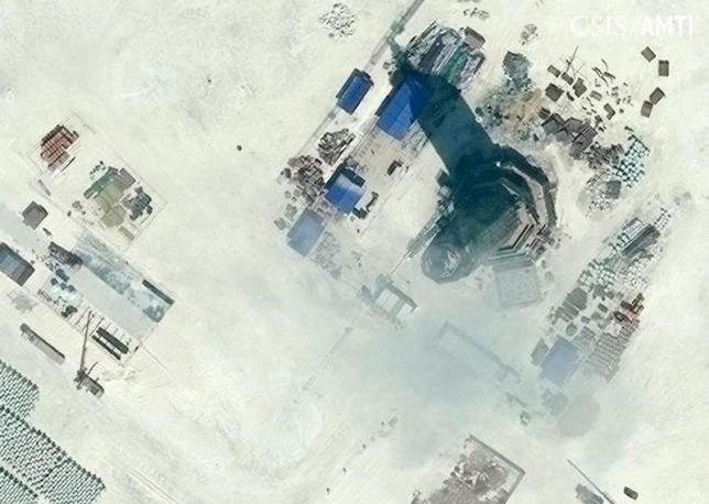 An octagonal tower with a conical feature at its top, located on the northeast side of Subi Reef was nearly complete measuring 40 feet on each side and 90 to 100 feet tall in this Center for Strategic and International Studies (CSIS) Asia Maritime Transparency Initiative January 8, 2016 satellite file image released to Reuters on January 15, 2016.