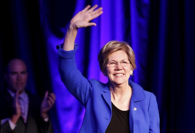 Senator Elizabeth Warren (D-MA) waves at the BlueGreen Alliance Foundation's 2015 Good Jobs, Green Jobs Conference in Washington, April 13, 2015.