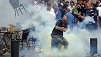 A teargas grenade explodes near an England fan ahead of England's EURO 2016 match in Marseille, France, June 10, 2016.