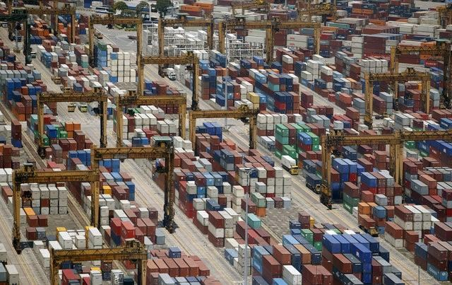 Containers are stacked up at PSA's Tanjong Pagar container terminal in Singapore July 24, 2015.