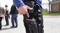 A gun rights supporter openly carries two pistols strapped to his leg during a rally in support of the Michigan Open Carry gun law in Romulus, Michigan April 27, 2014.