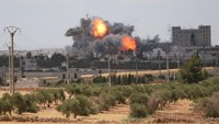 Smoke and flame rise after what fighters of the Syria Democratic Forces said were U.S.-led air strikes on the mills of Manbij, where Islamic State militants are positioned, in Aleppo Governorate, Syria.