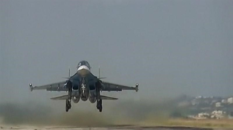 A still image taken from video footage, released by Russia's Defence Ministry on November 19, 2015, shows a Russian military jet taking off at Hmeimim airbase in Syria.