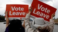 Leave the European Union campaigners wave banners near Parliament in London, Britain June 15, 2016.