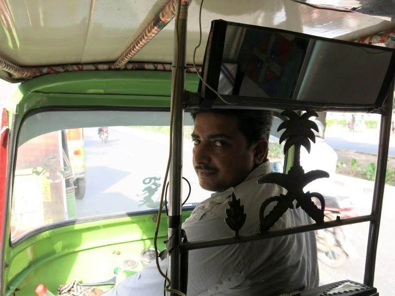 Rixi rickshaw driver Saeed Akhtar sits in his rickshaw in Lahore, Pakistan May 19, 2016.