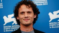 Cast member Anton Yelchin poses during the photo call for the movie 'Burying the ex' at the 71st Venice Film Festival September 4, 2014.