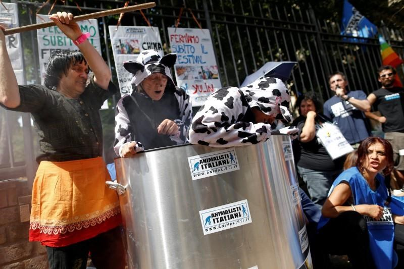 Animal activists protest against Yulin Dog Meat Festival in front of the Chinese embassy in Rome, Italy June 21, 2016.