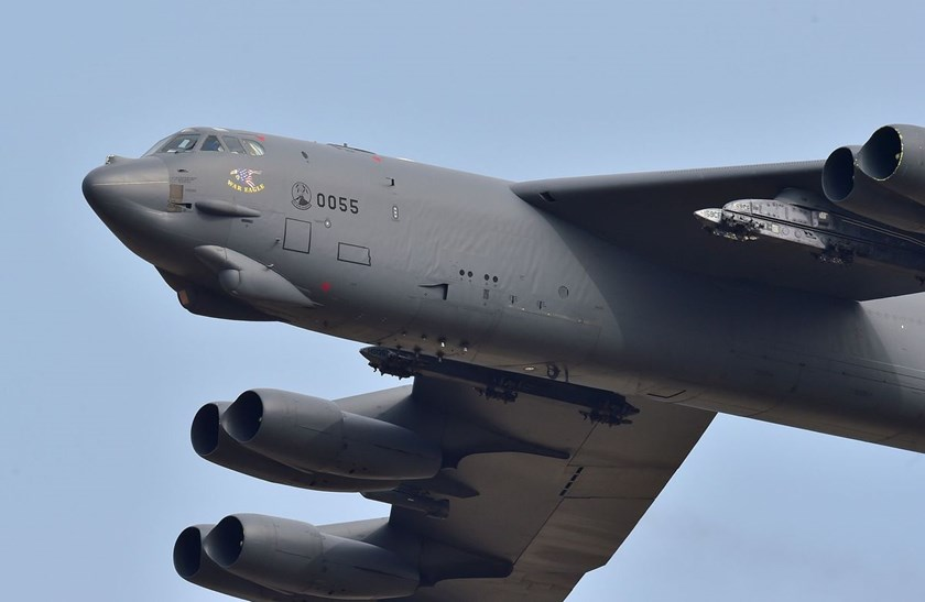 A U.S. B-52 flies over the Osan Air Base in Pyeongtaek, south of Seoul, on January 10, 2016. Photographer: Jung Yeon-Je/AFP via Getty Images