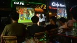 Men watch a Euro 2016 football match in a coffee shop in Hanoi. Photo: AFP