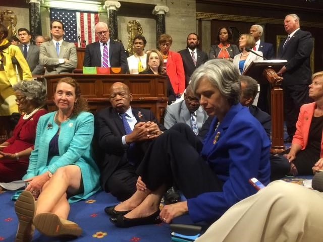 A photo shot and tweeted from the floor of the U.S. House of Representatives by U.S. House Rep. Katherine Clark shows Democratic members of the House staging a sit-in on the House floor 'to demand action on common sense gun legislation'