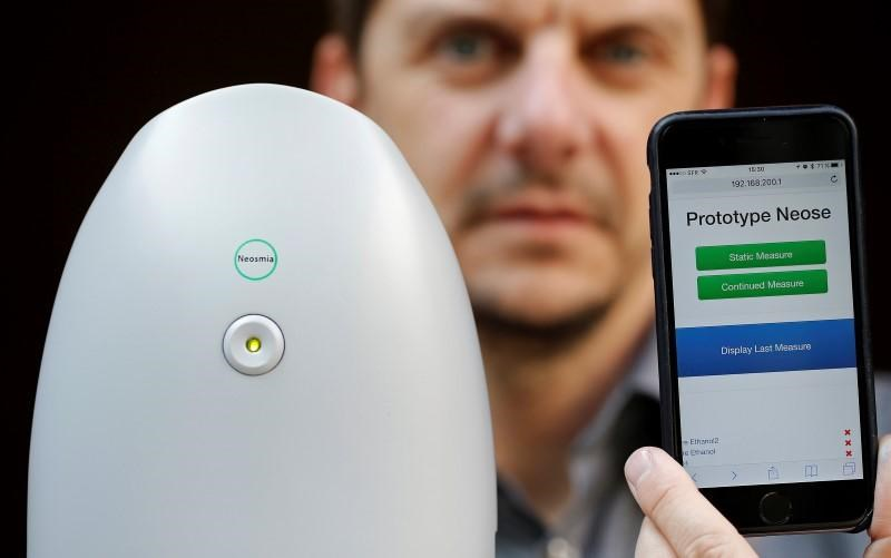 Aryballe Technologies CEO Tristan Rousselle shows a prototype of NeOse, a universal portable odour detection device connected to a database on a mobile phone, in Paris, April 20, 2016.