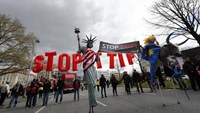 Protesters depicting Statue of Liberty (L) and Europa on the bull take part in a demonstration against Transatlantic Trade and Investment Partnership (TTIP) free trade agreement ahead of U.S. President Barack Obama's visit in Hannover, Germany April 23, 2016. REUTERS/Kai Pfaffenbach
