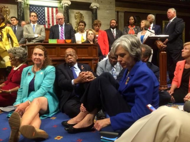 A photo shot and tweeted from the floor of the U.S. House of Representatives by U.S. House Rep. Katherine Clark shows Democratic members of the House staging a sit-in on the House floor ''to demand action on common sense gun legislation'' on Capitol Hill in Washington, United States, June 22, 2016. U.S. Rep. Katherine Clark/Handout via Reuters.