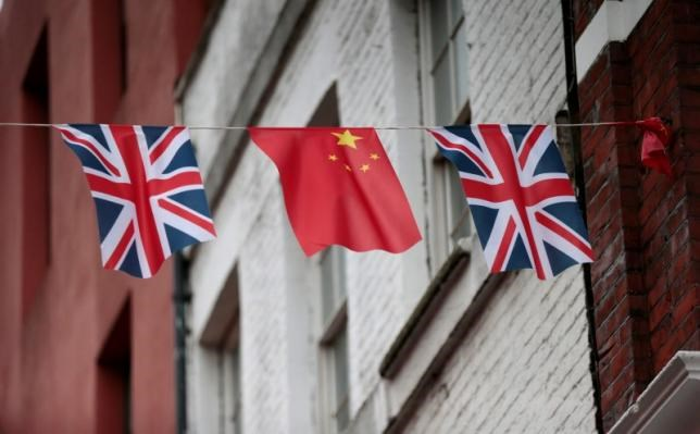 FILE PHOTO - Chinese and British flags fly in London's Chinatown, Britain October 19, 2015.