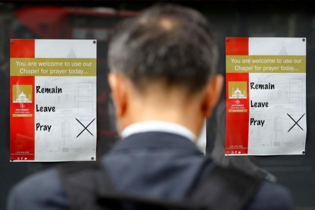 A man looks at a notice outside a polling station in central London, Britain, June 23, 2016.
