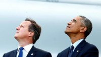Prime Minister David Cameron and President Barack Obama watch a fly-past by the Red Arrows during a 2014 NATO summit in Wales.