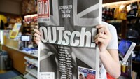 "A man holds up the German newspaper Bild with the titel ""OUTsch!"", for the camera, in Berlin, Germany, June 25, 2016."