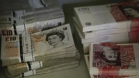 Wads of British Pound Sterling banknotes are stacked in piles at the GSA Austria (Money Service Austria) company's headquarters in Vienna July 22, 2013.