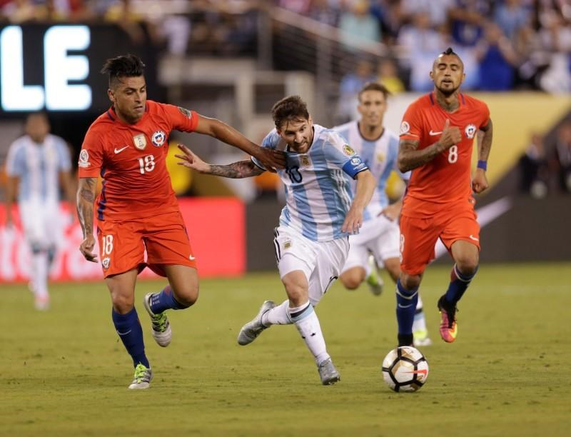 Jun 26, 2016; East Rutherford, NJ, USA; Argentina midfielder Lionel Messi (10) battles for the ball with Chile's Gonzalo Jara during the second half in the championship match of the 2016 Copa America Centenario soccer tournament at MetLife Stadium. Mandatory Credit: Adam Hunger-USA TODAY Sports