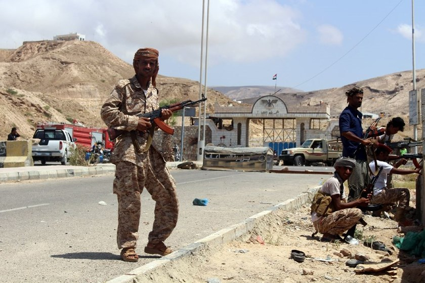 Yemeni soldiers stand guard outside a public security camp in the southeastern Yemeni port of Mukalla on May 15, 2016